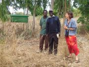 Margaret(Zikomo) and Winston (PFL) with head of local coop infront of beehive.