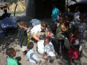 Gwilym (Zikomo) preparing mosquito nets with the children of Namakoma village in August 2008.