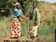Mr. Marikita and his wife using their treadle pump.