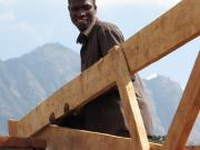 Foreman Edson Chingamwali getting the roof on before the rainy season